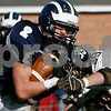 Swampscott: Swampscott junior Randall Kelleher protects the football while being tackled by Marblehead junior Evan Comeau during the 100th meeting of the rivals in Swampscott on Thursday. Swampscott won the game 21-13 to capture the Northeastern Conference Small championship. Photo by Matthew Viglianti/Staff Photographer Thursday, November 27, 2008.