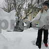 Beverly: Alexandra O'Donnell, 14, from Beverly clears the snow from the end of her driveway on Monday afternoon. O'Donnell, a freshman at Beverly High School, had the day off from school due to the snow, but didn't mind shoveling as a break from doing her homework. Photo by Matthew Viglianti/Staff Photographer Monday, March 2, 2009.