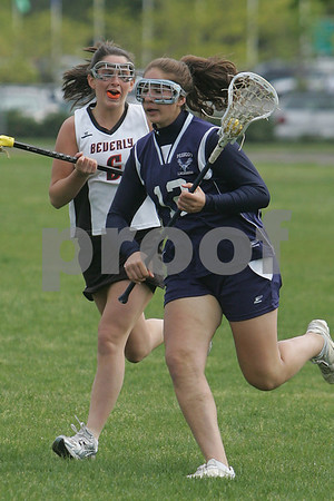 Beverly: Peabody attackman Britt LeFave, right, streaks past Beverly's Clare Leathersich during the Tanners' away game against Beverly on Monday. Photo by Matthew Viglianti/Staff Photographer Monday, May 18, 2009.
