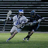 Danvers: Stephen Christopher from Danvers cuts away from Aaron McGill of Peabody during the third quarter of their team's game in Danvers on Thursday night. Photo by Matthew Viglianti/Staff Photographer Thursday, May 13, 2010.