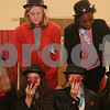 """Salem: Mildred Aroko, top right, makes a minor adjustment to an apple held by Katie Dube during a dress rehearsal for the Salem Academy Charter School's production of """"This is Not a Pipe Dream"""" in Old Town Hall in Salem on Wednesday. The one-act play tells the story of surrealist artist Rene Magritte. From left to right in front are Kate Harten, Natasha Vasquez, Lydia King, and Katie Dube, who play the Anonymous Men. In back from left to right are Kayleigh Krajeski and Mildred Aroko, who play the interloquters. Photo by Matt Viglianti/Salem News Wednesday, December 10, 2008"""