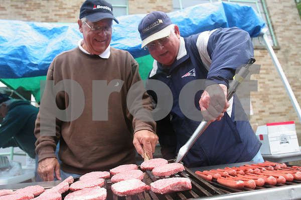 Peabody: Ray LaBrique, left, and Ron Plante of Salem work the grill at the St. Thomas the Apostle annual picnic on Sunday afternoon. Photo by Matthew Viglianti/Staff Photographer Sunday, June 21, 2009.