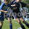 Danvers: Madeline Dove from the Swampscott U-12 Blue Lightning, right, fights for possesion of the ball with Sydney Packard from the Georgetown U-12 Blue Storm during the 2009 Danvers Invitational Tournament at Danvers High School on Monday. The 18th annual tournament hosted over 180 teams. Swampscott won their game against Georgetown 2-0 to advance to the next round. Photo by Matthew Viglianti/Staff Photographer Monday, May 25, 2009.