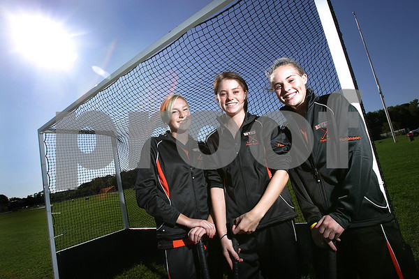 Beverly: From left, Beverly senior field hockey players Haley Govoni, captain Meg Finn, and captain Courtney Robinson have all contributed to the team's good start this. Govoni has tallied 16 goals in just 11 games, while Finn has scored five goals and eight assits to lead a high powered offense. Robinson has anchored a tough defense that is sometimes overshadowed by the strength of the offense. Photo by Matt Viglianti/Salem News Tuesday, October 07, 2008