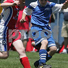 Danvers: Ryan Buchanan from the Danvers U-12 boys team, right, works to get past Sean Crandall from the U-12 boys team from Portsmouth during the 2009 Danvers Invitational Tournament at Danvers High School on Monday. The 18th annual tournament hosted over 180 teams. Photo by Matthew Viglianti/Staff Photographer Monday, May 25, 2009.