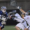 Cambridge: St. John's Prep junior Colin Blackwell fires a shot past Duxbury senior midfielder Nick Woodgate, center, and senior goalie Makar Zaverucha, for a first half goal during the Division 1 state championship game between St. John's Prep and Duxbury at Harvard Stadium in Cambridge on Wednesday night. The Prep won the game 12-11 in sudden death overtime to take the state title. Photo by Matthew Viglianti/Staff Photographer Wednesday, June 16, 2010.