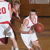 Topsfield: Masconomet sophomore guard Adam Bramanti, right, drives to the basket as Masco senior John Daniels (20) sets a pick on Bramanti's Newburyport defender, Kyle Vhlisi, during the first half of Masco's home game against Newburyport on Thursday. Photo by Matthew Viglianti/Staff Photographer Thursday, January 7, 2009.