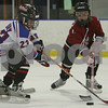 Salem: Will Jones from Marblehead, left, tries to keep the puck away from Halle Livermore from Marblehead, right, during practice with the Marblehead Mites 1 hockey team at Salem State on Sunday. Photo by Matt Viglianti/Salem News Sunday, January 18, 2009