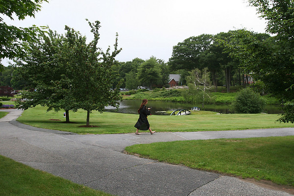 Beverly: A member of the Beverly High School class of 2010 walks through the Endicott College campus in her gown on her way to the Post Center, where graduation ceremonies for the class were held on Sunday. Photo by Matthew Viglianti/Staff Photographer Sunday, June 13, 2010.
