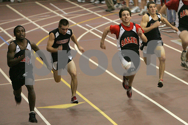 Marblehead: Salem senior Melikke Van Alstyne, left, leads the pack in the 55-meter dash during a meet between Beverly, Swampscott, Marblehead, and Salem in Marblehead on Thursday. Photo by Matthew Viglianti/Staff Photographer Thursday, December 11, 2008.