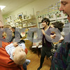 Salem: Anson Froeschl from Salem, 7 months, gets an upside-down view as Tony Boisvert from Salem, right, comes over to say hello to Anson and his father, Scott, during a wine tasting and silent auction at Crunchy Granola Baby on Washington Street in Salem on Thursday. Money raised at the event will go to the Forest River Park Playground Fund. Photo by Matt Viglianti/Salem News Thursday, November 06, 2008