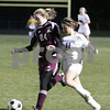 Danvers: Danvers sophomore forward Brittany Russo, right, struggles to break past Belmont's junior defender Kasey Reynolds during the second half of the Falcon's Division 2 North quarterfinal game against Belmont in Danvers on Tuesday. Belmont won the game 2-1 to advance to the next round of the tournament. Photo by Matt Viglianti/Salem News Tuesday, November 11, 2008