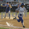 Lowell: Danvers junior captain Joanna Zecha sprints to beat out a bunt attempt as Lexington senior captain Joelle Zahka, left, fires to first for the Minutemen during the fifth inning of their teams' Division 1 North final game in Lowell on Monday. Zecha was called out on the play, and Lexington went on to win 5-3 to advance to the next round of the state tournament. Photo by Matthew Viglianti/Staff Photographer Monday, June 8, 2009.