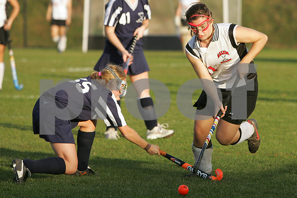Salem: Madeleine Lutts from Salem, right, dribbles through a challenge by Andrea Saccardo from Peabody during the second half of the Witches' 2-1 win over Peabody in Salem on Tuesday. Photo by Matt Viglianti/Salem News Tuesday, October 14, 2008