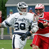 Danvers: Matt Scalise, a junior attack at St. John's Prep, left, protects the ball from Barnstable sophomore Aurelio Dimuzio during their team's Division 1 quarterfinals in Danvers on Wednesday. The Prep won the game 20-13. Photo by Matthew Viglianti/Staff Photographer Wednesday, June 9, 2010.