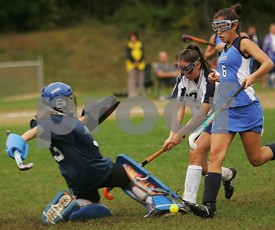 Peabody: Danvers goalie Diana Bean lunges to make a save as Peabody's Kerrie O'Shea, center, looks to make a play against Danvers defender Rebecca Leslie, right, during the first half of their game in Peabody on Monday. Photo by Matt Viglianti/Salem News Monday, September 29, 2008