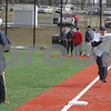 Danvers: Patrick Yanchus, St. John's Prep varsity baseball coach, times senior Chris Carmain as Carmain sprints from home plate to first base during the first day of tryouts for the team on Monday afternoon. Photo by Matthew Viglianti/Staff Photographer Monday, March 16, 2009.
