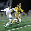 Weymouth: Masconomet junior John Miller gets a shot off ahead of a pair of Nauset defenders during the first half of Masco's state semifinal game against Nauset in Weymouth on Tuesday. Photo by Matthew Viglianti/Staff Photographer Tuesday, November 18, 2008.