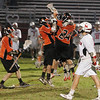 Marblehead: The Marblehead Magicians leave the field as the Beverly lacrosse team celebrates it's 8-6 win over Marblehead to capture sole possession of the Northeastern Conference championship on Wednesday night. A Marblehead victory on Wednesday would have earned them a share of the championship with Beverly. Photo by Matthew Viglianti/Staff Photographer Wednesday, May 26, 2010.