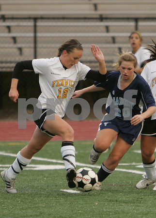 Peabody: Bishop Fenwick sophomore Brittany Dolan, left, tries to sprint with the ball past Caitlyn Pinkham from Peabody during the first half of their teams' game at Fenwick on Monday. The game ended in a 2-2 tie. Photo by Matt Viglianti/Salem News Monday, November 03, 2008