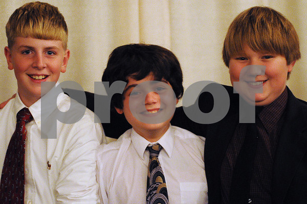 Danvers: From left to right, Sam Crum 12, Don Bean, 13, and Dane Elliott, 12, at the Danvers Youth Football banquet on Wednesday night. Photo by Matthew Viglianti/Staff photographer Wednesday, November 11, 2009.
