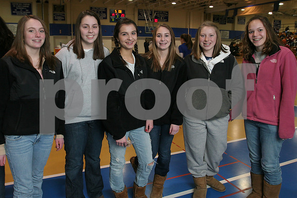 Danvers: From left, Sarah Potter, Andrea Zelano, Katie Gonzalez, Jill Stirrat, and Katie Hart from Danvers, and Monica Poeske from Beverly, pose at halftime of the Bishop Fenwick girls basketball team's game against Masconomet in the championship of the North Shore High School Hoop Invitational game in Danvers on Tuesday. Photo by Matthew Viglianti/Staff Photographer Tuesday, February 16, 2009.