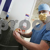 Salem: Sean Charles scrubs in for work in the cardiology wing at Salem Hospital on Wednesday. Charles will have his artistic work featured at the Marblehead Arts Association Exhibit. Photo by Matt Viglianti/Salem News Wednesday, February 25, 2009