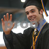 Beverly: Dylan Zierk waves to the crowd while walking to his seat for graduation at Beverly High School on Sunday afternoon. Photo by Matthew Viglianti/Staff Photographer Sunday, June 14, 2009.