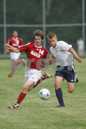 Hamilton: Masconomet junior Kevin McAllister, left, and Hamilton-Wenham sophomore Matt Herrick battle for a loose ball during their game in Hamilton on Tuesday. Photo by Matt Viglianti/Salem News Tuesday, September 16, 2008