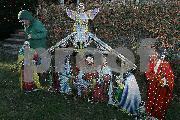 Beverly: XXXXXX Carnavale of Beverly surveys a nativity scene he set up in the front yard of his Dodge Street home on Thursday afternoon. Carnavale tends to hang his lawn decorations early, but doesn't plan to light them at night until after Thanksgiving. Photo by Matthew Viglianti/Staff Photographer Thursday, November 20, 2008.