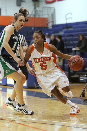 Salem: Salem State junior Jakoya Williams (5) drives around Endicott senior Nicole Duchesne during the first half of the teams' game at Salem State on Wednesday. Photo by Matt Viglianti/Salem News Wednesday, January 07, 2009