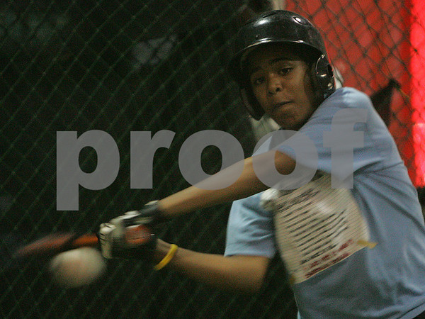 Swampscott: Christopher Pimentel, 12, from Salem, makes contact during batting practice with the Salem National Little League all-star team at The Hit Zone in Swampscott on Wednesday. Photo by Matthew Viglianti/Staff Photographer Wednesday, June 24, 2009.