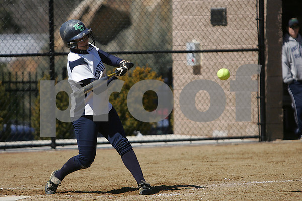 Beverly: Sarah Spaziano, a junior at Endicott, connects for a second inning double to drive in senior Meghan Sargent during the Gulls' home game against New England College in Beverly on Sunday. Photo by Matthew Viglianti/Staff Photographer Sunday, April 5, 2009.