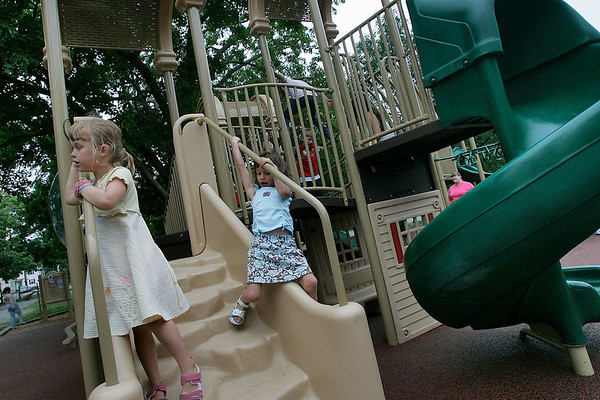 Salem: Charlotte Ross, left, and Reilly De Jesus, both 5 from Salem, enjoy an afternoon playing at the newly renovated playground on Salem Common on Wednesday. Photo by Matthew Viglianti/Staff Photographer Wednesday, June 9, 2010.