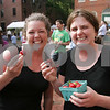 Salem: Salem sisters Aimee, left, and Susana Sinclair enjoy strawberries from Clark Farm in Danvers at the debut of the weekly Salem Farmers Market in Derby Square on Thursday. Photo by Matthew Viglianti/Staff Photographer Thursday, June 25, 2009.