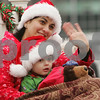 Beverly: A woman holding a young child waves to parade goers from her float during the annual holiday parade in Beverly on Sunday. Photo by Matt Viglianti/Salem News Sunday, November 30, 2008