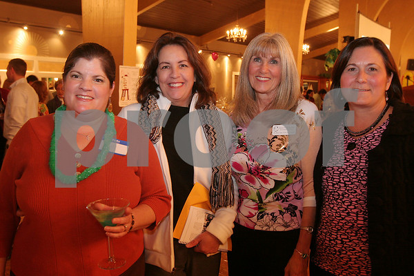 Danvers: From left to right, Amy Fowler, Nancy Scialdone, Anna Bertini, and Lyne McAuliffe, enjoy the Stargaritaville fundraising event for the St. Mary Star of the Sea School in Danvers on Thursday night. Photo by Matthew Viglianti/Staff Photographer Thursday, November 5, 2009.
