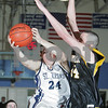 Danvers: St. John's Prep sophomore captain Pat Connaughton, left, struggles to get a shot off against Bishop Fenwick senior captain Mike Clifford during the championship game of the North Shore High School Hoop Invitational at Danvers High School on Monday night. Fenwick won the game. Photo by Matthew Viglianti/Staff Photographer Monday, February 16, 2009.