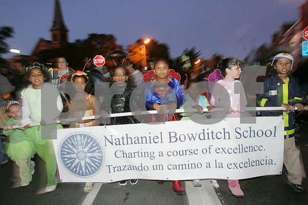 Salem: Children from the Nathaniel Bowditch School in Salem march with their banner during the Haunted Happenings Parade. Photo by Matt Viglianti/Salem News Thursday, October 02, 2008