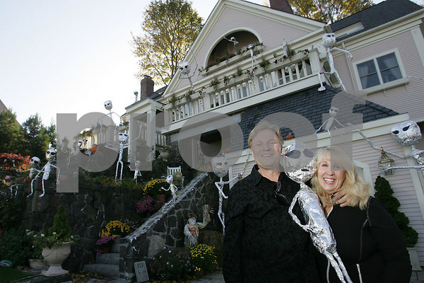 Marblehead: Alex Gediman and his wife, DD Swan Gediman pose with one of the 27 pipe and foil aliens decorating the front of their home on Beacon Street in Marblehead on Sunday afternoon. Photo by Matt Viglianti/Salem News Sunday, October 26, 2008