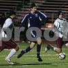 Weymouth: Hamilton-Wenham senior captain Jon Britton splits a pair of Carver defenders on his way to goal during the second half of the Generals' state semifinal tournament game against Carver in Weymouth on Tuesday. The Generals notched a 1-0 win to advance to the state finals this Saturday. Photo by Matthew Viglianti/Staff Photographer Tuesday, November 18, 2008.