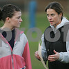 Peabody: Jessica Leslie, left, listens as head coach Brooke Randall, a math teacher at Peabody High School, gives instruction during a Powder Puff football practice on Monday afternoon. The school recently established the team, which will play its first game against Revere on Saturday. Photo by Matthew Viglianti/Staff Photographer Monday, November 17, 2008.