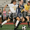 Peabody: Bishop Fenwick sophomore Lauren Toye-O'Donnell streaks past Archbishop Williams junior Colleen Downing during the first half of Fenwick's 5-2 win over Archbishop Williams on Wednesday. Photo by Matt Viglianti/Salem News Wednesday, October 08, 2008
