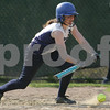 Swampscott: Mallarie McGrath lays down a bunt for Swampscott during the team's home game against Salem on Monday afternoon. Photo by Matthew Viglianti/Staff Photographer Monday, April 27, 2009.