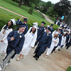 Hamilton: Julian Flynn waves on his way into the Gordon College chapel for graduation ceremonies with the Hamilton-Wenham class of 2010 on Sunday. Photo by Matthew Viglianti/Staff Photographer Sunday, June 13, 2010.