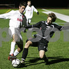 Woburn: Fouad Shahin from Masconomet, left, tries to maintain possession while under pressure from a Winchester defender during their teams' Division 2 North final in Woburn on Sunday. Masconomet won the game 2-0 to advance to the next tournament round. Photo by Matthew Viglianti/Staff Photographer Sunday, November 16, 2008.
