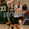 Peabody: Bishop Fenwick junior Lizzy Trainor makes a strong move to the baseline after beating Matignon defenders, captain Jackie Kelley (21) and Terri Deluise during the first period of the Crusaders' home game on Tuesday. Photo by Matt Viglianti/Salem News Tuesday, January 20, 2009