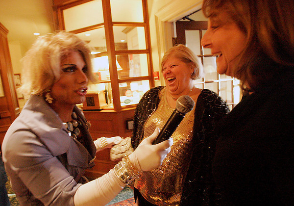 "Salem: Dressed as Joan Rivers, celebrity impersonator Joe Posa greets Darlene Mobilia of Beverly, center, and Andrea Mobilia of Middleton at the entrance to the Hawthorne Hotel in Salem during the ""Hello to Hollywood"" fete - ""You Oughta be in Pictures fundraiser on Thursday. The event benefits North Shore Elder Services. Photo by Matthew Viglianti/Staff Photographer Thursday, April 29, 2010."
