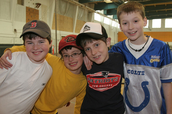 Beverly: From left to right, nine-year-olds William Ullmann, Jonathan Tricomi, Luke Fidrych, and Conor Dunleavy participated in the 28th annual Beverly Little League indoor winter clinic at Beverly High School on Sunday. Photo by Matthew Viglianti/Staff Photographer Sunday, January 24, 2010.