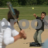 Danvers: Tyler Doliber from Danvers, 7, practices pitching against his mother, Jen, on a beautiful Monday afternoon at Plains Park in Danvers. Tyler plays for the Athletics in the Danvers American Little League. Photo by Matthew Viglianti/Staff Photographer Monday, June 8, 2009.